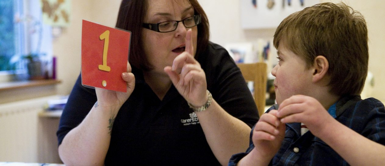 carer support worker providing respite activity for seven year old boy