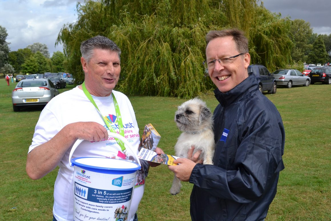 Volunteer Richard Reeve with donation bucket