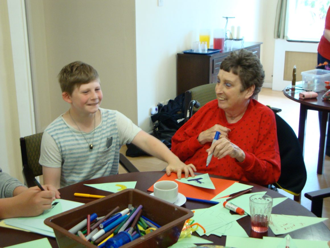 Young carer and elderly person