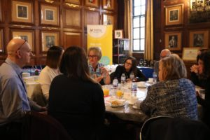 Discussions around table at Peterborough Carers Rights Day event 21 November 2019