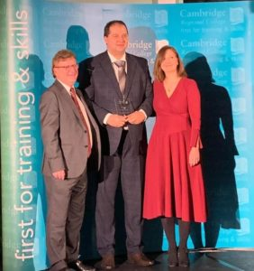 Employer of the Year for Health and Social Care at the Cambridge Regional College Apprenticeship Awards 2020. Anna Bainbridge and Michal Morkowski of Caring Together were presented with the award by Mark Robertson, principal of Cambridge Regional College.