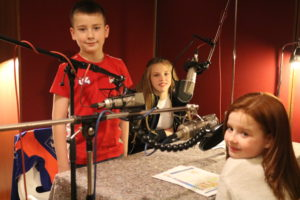 In the studio recording voices for primary schools animation